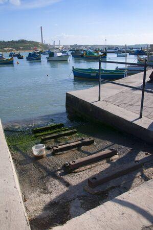slipway: Boat Slipway on the Harbour in Marsaxlokk on the island of Malta