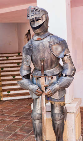 Suit of Armour in Mijas one of the most beautiful white villages of Andalucia. It is in the Alpujarra mountains above the coast Stock Photo