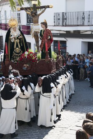 house donkey: Easter procession in Mijas one of the most beautiful white villages of Andalucia. It is in the Alpujarra mountains above the coast