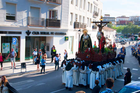 house donkey: Easter Procession in Mijas one of the most beautiful white villages of Andalucia. It is in the Alpujarra mountains above the coast Editorial
