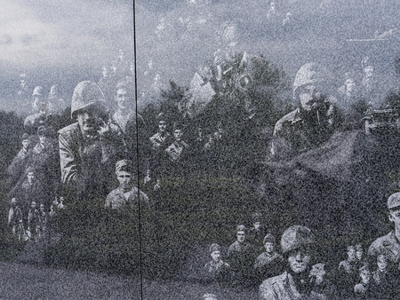Marble wall etched with images from the Korean War in Washington USA