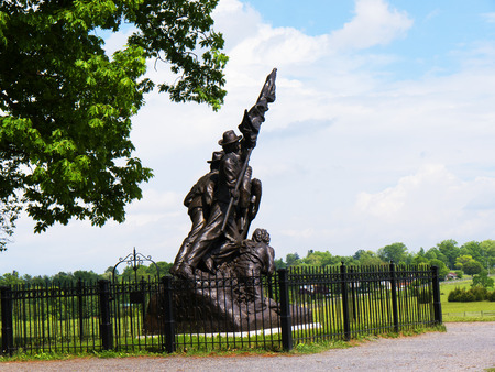 battlefield: The Battlefield in Gettysburg Pennsylvania which is dotted to many memorials to the fallen and to commemorate the individuals involved Editorial
