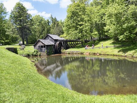 grist: Mabry Mill was a grist mill  grinding grain into flour on the Blue Ridge Parkway in Virginia and it is one of the most photographed places in America and has been featured on a great many calendars Editorial
