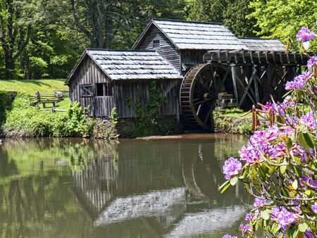 grist mill: Mabry Mill was a grist mill  grinding grain into flour on the Blue Ridge Parkway in Virginia and it is one of the most photographed places in America and has been featured on a great many calendars Editorial