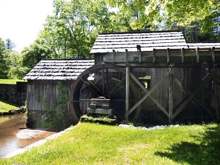 grist: Mabry Mill was a grist mill  grinding grain into flour on the Blue Ridge Parkway in Virginia and it is one of the most photographed places in America and has been featured on a great many calendars Editoriali