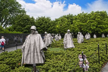 unnamed: The Korean wall memorial depict 19 statues that depict soldiers on patrol. A granite wall has a mural of the faces of 2,400 unnamed soldiers with a reading that states Freedom is not free. Editorial