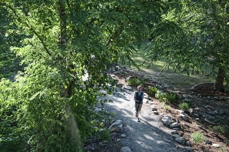 asheville: Walking at Chimney Rock State Park in Asheville North Carolina USA overlooking Hickory Nut Gorge