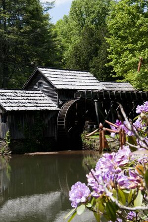 basket weaving: Mabry Mill was a grist mill  grinding grain into flour on the Blue Ridge Parkway in Virginia and it is one of the most photographed places in America