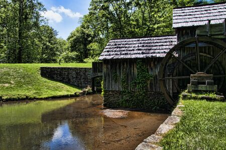 grist mill: Mabry Mill was a grist mill  grinding grain into flour on the Blue Ridge Parkway in Virginia and it is one of the most photographed places in America