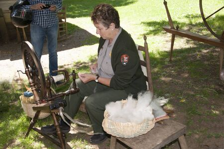 basket weaving: Spinning demo at Mabry Mill was a grist mill  grinding grain into flour on the Blue Ridge Parkway in Virginia and it is one of the most photographed places in America Editorial