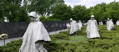 depict: The Korean wall memorial depict 19 statues that depict soldiers on patrol. A granite wall has a mural of the faces of 2,400 unnamed soldiers with a reading that states Freedom is not free. Editorial