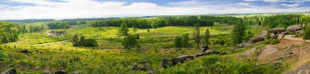 battlefield: The Battlefield in Gettysburg Pennsylvania which is dotted to many memorials to the fallen and to commemorate the individuals involved Stock Photo