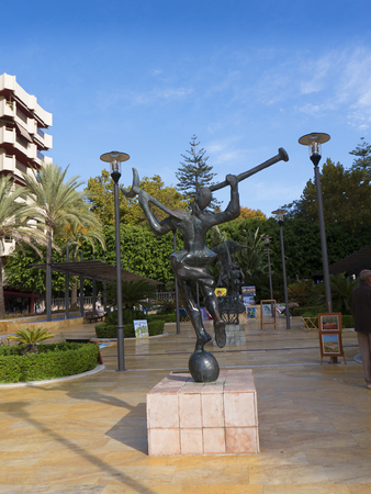 surrealist: Street of Million Pound Surrealist Statues by Salvadore Dali in the Stylist Town of Marbella on the Costa del Sol Spain Editorial
