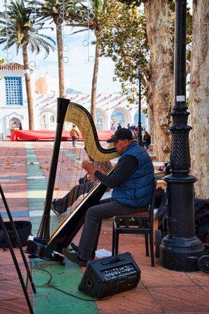 balcon: Harpist on the Balcon de Europa in Nerja Spain