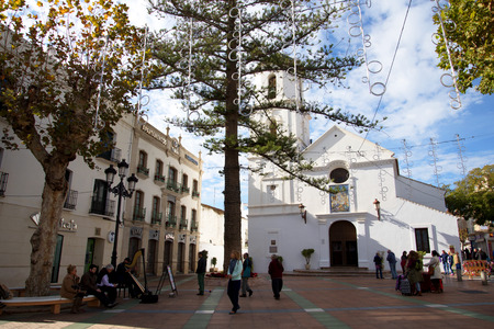 nerja: the Church of El Salvador is situated opposite the Balcon de Europa in Nerja Spain