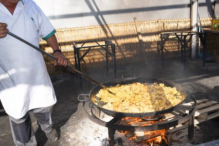burriana beach: Serving a huge pan of Paella on the Burriana Beach in Nerja Andalucia Spain Editorial