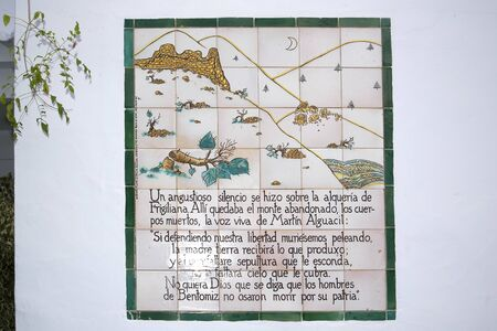frigiliana: One of the ceramic plaques that tell the story of Frigiliana in Andalucia Spain which shows the Moorish villages last battle against the Christians in 1496