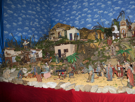 Christmas crib in Church interior in Frigiliana one of the most beautiful white villages of the Southern Spain area of Andalucia in the Alpujarra mountains. Editorial
