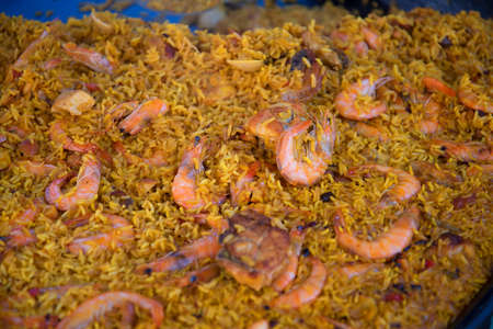burriana beach: Serving a huge pan of Paella on the Burriana Beach in Nerja Andalucia Spain Stock Photo