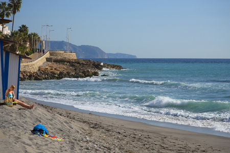 Beach scenes in Nerja, a sleepy Spanish Holiday resort on the Costa Del Sol  near Malaga, Andalucia, Spain