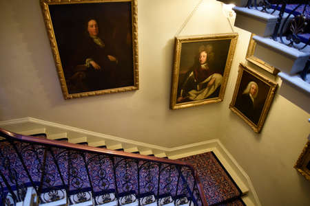 jacobean: Portraits down a staircase in Temple Newsam House in Leeds Yorkshire