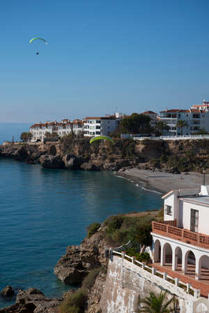 nerja: Paraglider from the Balcon de Europa is a viewpoint down the coast set in the cliffs in Nerja Spain
