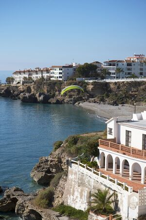 europa: Paraglider from the Balcon de Europa is a viewpoint down the coast set in the cliffs in Nerja Spain