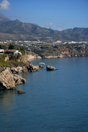 balcon: View from the Balcon de Europa is a viewpoint down the coast set in the cliffs in Nerja Spain