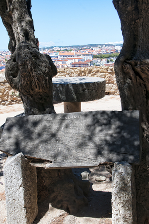 commanding: Sao Jorge Castle is a Moorish castle occupying a commanding hilltop overlooking the historic centre of the Portuguese city of Lisbon and Tagus River.