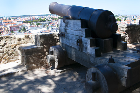 the tagus: Cannon at Sao Jorge Castle which is a Moorish castle occupying a commanding hilltop overlooking the historic centre of the Portuguese city of Lisbon and Tagus River. Editorial