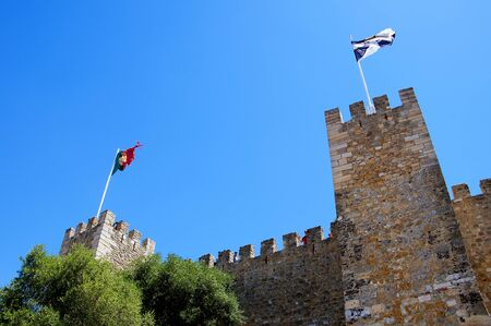 occupying: Sao Jorge Castle is a Moorish castle occupying a commanding hilltop overlooking the historic centre of the Portuguese city of Lisbon and Tagus River.