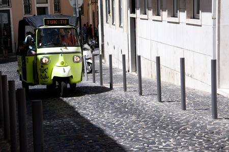 brenda kean: Tuctuc in the Alfama is the oldest district of Lisbon, it spreads down the southern slope from the Castle of So Jorge to the River Tagus