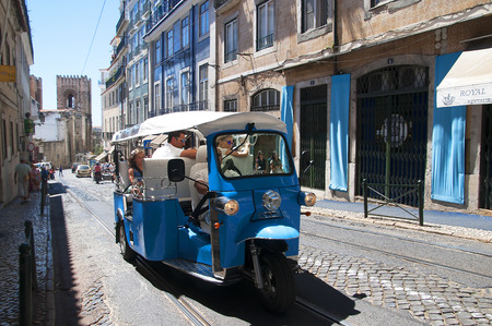 oldest: Tuctuc in the Alfama is the oldest district of Lisbon, it spreads down the southern slope from the Castle of So Jorge to the River Tagus