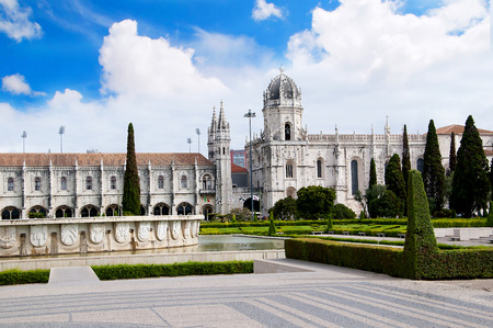 centred: The Jernimos Monastery  with the Praa do Imprio: gardens centred upon a large fountain, laid out during World War II in Lisbon Portugal