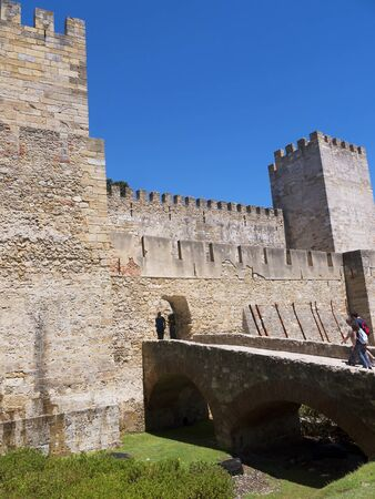 commanding: Sao Jorge Castle is a Moorish castle occupying a commanding hilltop overlooking the historic centre of the Portuguese city of Lisbon and Tagus River. The strongly fortified citadel dates from medieval period of Portuguese history, and is one of the main t