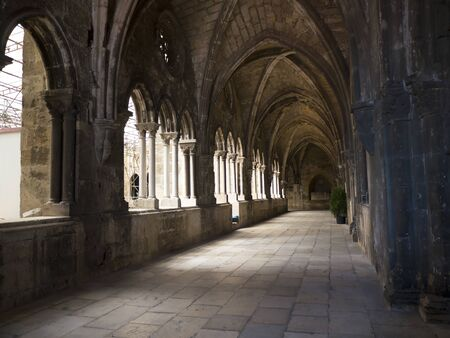 cloister: Gothic cloister of Lisbon Cathedral. Each oculum over the twin arches has a different tracery pattern. Editorial