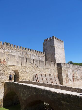 occupying: Sao Jorge Castle is a Moorish castle occupying a commanding hilltop overlooking the historic centre of the Portuguese city of Lisbon and Tagus River. The strongly fortified citadel dates from medieval period of Portuguese history, and is one of the main t