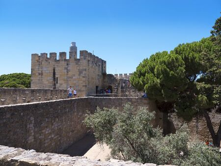 o jorge: São Jorge Castle is a Moorish castle occupying a commanding hilltop overlooking the historic centre of the Portuguese city of Lisbon and Tagus River. The strongly fortified citadel dates from medieval period of Portuguese history, and is one of the main  Editorial
