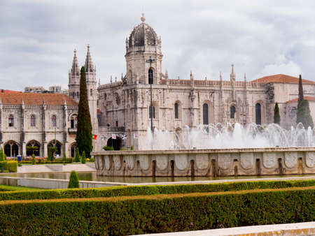 centred: The Jeronimos Monastery  with the Praca do Imperio: gardens centred upon a large fountain, laid out during World War II in Lisbon Portugal