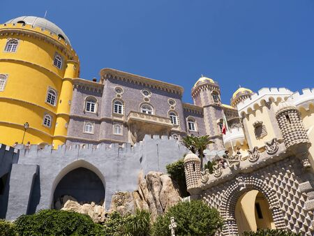 approached: Palacio da Pena in Sintra Portugal is a wild fantasy of domes,towers,crennelations and ramparts approached from a drawbridge that does not draw.