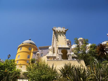approached: Palacio da Pena in Sintra Portugal is a wild fantasy of domes,towers,crennelations and ramparts approached from a drawbridge that does not draw. This