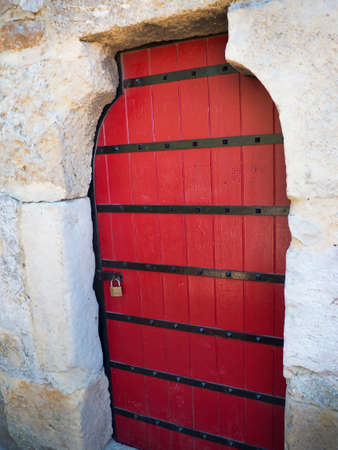 crusaders: Doorway in Sao Jorge Castle is a Moorish castle occupying a commanding hilltop overlooking the historic centre of the Portuguese city of Lisbon and Tagus River.