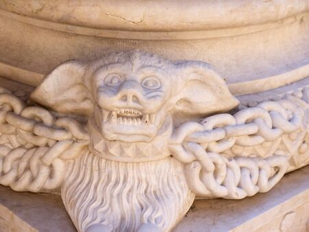 vampire bat: Stone Carving in the Patriarchal Cathedral of St. Mary Major or Lisbon Cathedral of a vampire bat Stock Photo