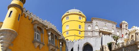 approached: Palacio da Pena in Sintra Portugal is a wild fantasy of domes,towers,crennelations and ramparts approached from a drawbridge that does not draw
