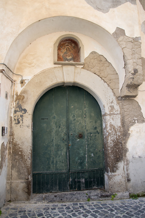 sirens: Old Door in one of the back road of old Sorrento Italy Editorial