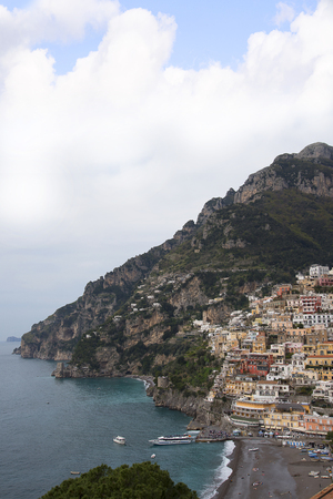 tiers: Positano is very original; its buildings cling, in tiers to the rock face. The small houses, all huddling on top of each other form the subject of endless photos. Stock Photo