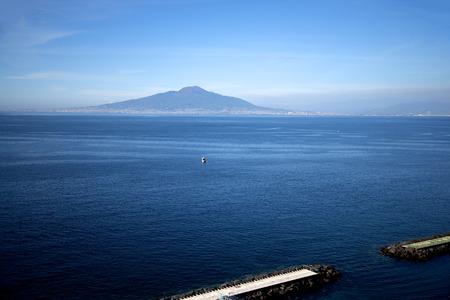 sirens: Mount Vesuvius across the bay of Naples from Sorrento Italy Stock Photo
