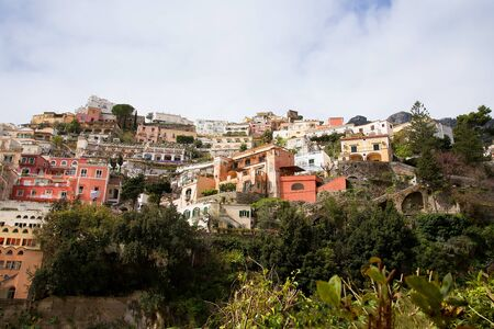 steinbeck: Positano with its pastel coloured buildings down to the sea Stock Photo