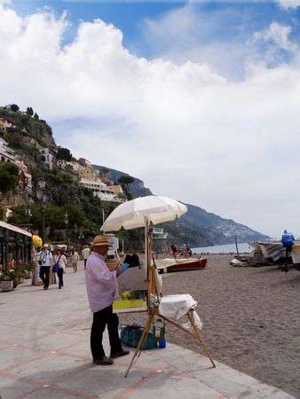 positano: Artist on the beach in Positano on the Bay of Salerno in Campania Southern Italy