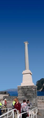 roman column: Roman Column on the harbour wall in Capri Italy Editorial